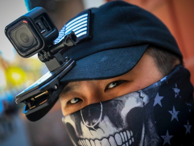 """Eddie Song a Korean American entrepreneur, arrives at his motorcycle storage garage wearing a video camera clipped to his cap and a face mask due to COVID-19, Sunday April 19, 2020, in East Village neighborhood of New York. """"I was assaulted a few months ago by someone who said that …"""