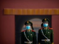 Chinese paramilitary police wear face masks to protect against the spread of the new coronavirus as they stand in formation outside an entrance to the Forbidden City in Beijing, Friday, May 1, 2020. The Forbidden City reopened beginning on Friday, China's May Day holiday, to limited visitors after being closed …
