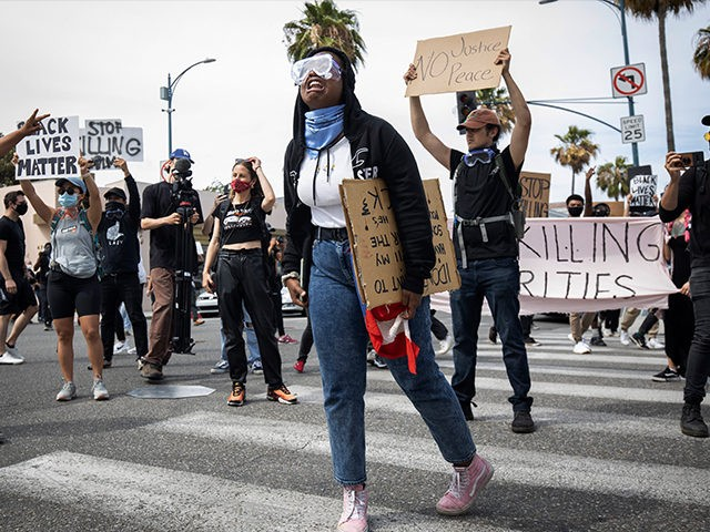 Protesters march in Beverly Hills, Calif., on Saturday, May 30, 2020, over the death of George Floyd, who died in police custody on Memorial Day in Minneapolis. (AP Photo/Christian Monterrosa)