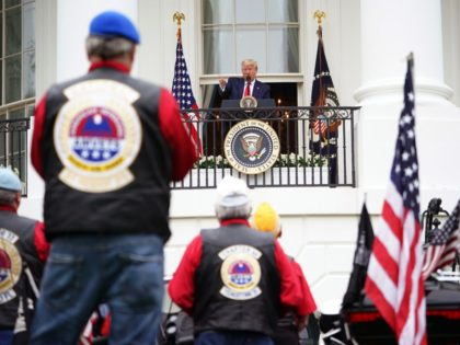 "US President Donald Trump speaks during the ""Rolling to Remember Ceremony: Honoring Our Nations Veterans and POW/MIA"" on May 22, 2020, from the Truman Balcony at the White House in Washington, DC. - The US is observing Memorial Day on May 25 honoring the men and women who died while …"