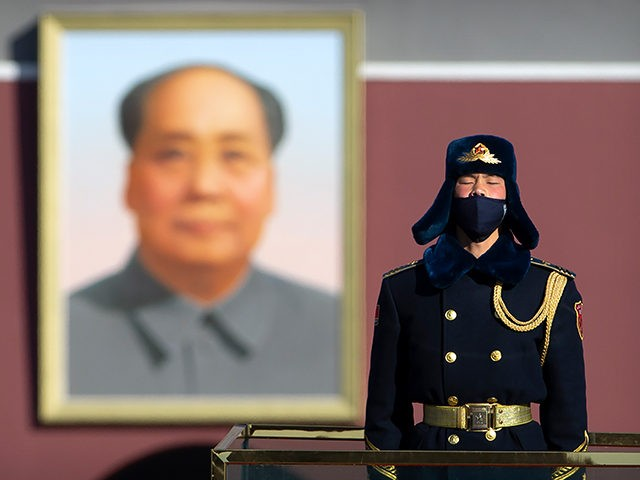 A member of a Chinese honor guard wears a face mask as he stands guard on Tiananmen Square in Beijing, Tuesday, Feb. 4, 2020. China said Tuesday the number of infections from a new virus surpassed 20,000 as medical workers and patients arrived at a new hospital and President Xi …