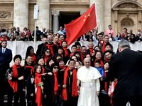 Pope Francis poses for a picture with faithful from China as he arrives for his weekly general audience on April 18, 2018, on St. Peter's square in the Vatican. / AFP PHOTO / TIZIANA FABI (Photo credit should read TIZIANA FABI/AFP via Getty Images)