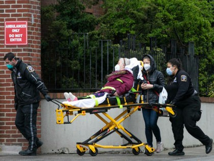 A patient is moved by an ambulance team at NewYork–Presbyterian Brooklyn Methodist Hospital, Wednesday, May 6, 2020, in New York during the coronavirus pandemic. The great majority of people newly hospitalized with the coronavirus in New York are either retired or unemployed and were avoiding public transit, according to a …