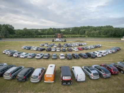 Cinema-goers watch a movie from their cars at a drive-in theater in Les Herbiers, western France, on May 22, 2020, as France eases lockdown measures taken to curb the spread of the COVID-19 disease caused by the novel coronavirus. (Photo by LOIC VENANCE / AFP) (Photo by LOIC VENANCE/AFP via …