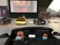 Passengers watch a movie from their car at a drive-in cinema outside the Mall of Emirates in Dubai on May 17, 2020, during the COVID-19 pandemic. (Photo by Karim SAHIB / AFP) (Photo by KARIM SAHIB/AFP via Getty Images)
