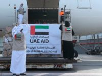 In this Tuesday, May 19, 2020 photo released by the state-run WAM news agency, an Etihad Airways flights loaded with aid for the Palestinians to fight the coronavirus pandemic is loaded in Abu Dhabi, United Arab Emirates. Etihad Airways flew aid for the Palestinians amid the coronavirus pandemic from the …