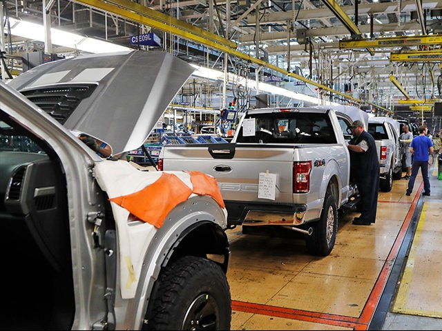 FILE - In this Sept. 27, 2018, file photo a United Auto Workers assemblymen work on a 2018 Ford F-150 trucks being assembled at the Ford Rouge assembly plant in Dearborn, Mich. The United Auto Workers union wants Detroit's three automakers to shut down their factories for two weeks to …