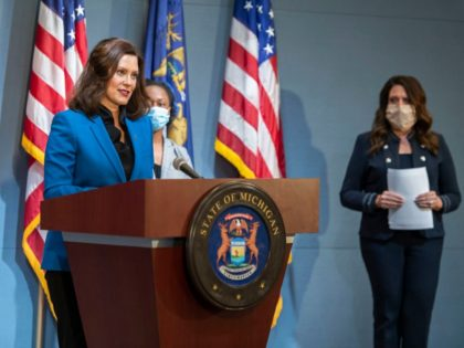 In a pool photo provided by the Michigan Office of the Governor, Michigan Gov. Gretchen Whitmer addresses the state during a speech in Lansing, Mich., Monday, May 11, 2020. Protests against Whitmer have erupted in recent weeks as she has put in place restrictions on businesses and Michigan residents, including …