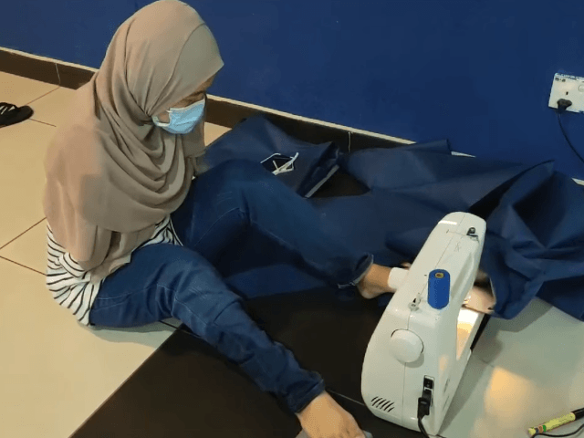 """Many people have been asking to see how I use a sewing machine, so I'll show you my own method when sewing with my feet,"" Norfarrah Syahirah Shaari wrote in a video posted to her Facebook page."