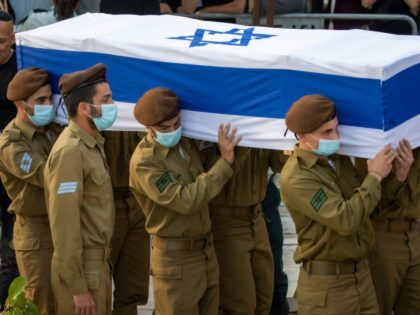 Israeli soldiers wear face masks to protect against the spread of the coronavirus carry the coffin of Israeli army Staff Sgt. Amit Ben-Yigal during his funeral in Beer Yaakov, Israel, Tuesday, May 12, 2020. Ben Ygal, 21, was killed early Tuesday during a West Bank arrest raid when a rock …
