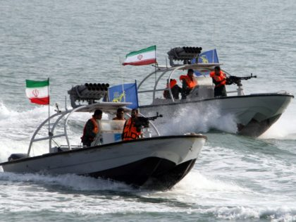 Iranian Revolutionary Guards drive speedboats during a ceremony to commemorate the 24th anniversary of the downing of Iran Air flight 655 by the US navy, at the port of Bandar Abbas on July 2, 2012. The plane was shot down by mistake over the Gulf by the US navy's guided …