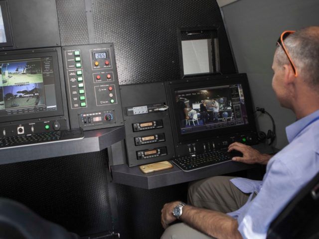 A representative of an Israeli company demonstrates a mobile command and control station hidden in a truck during an expo of Israeli intelligence-gathering technology in Tel Aviv, Israel, Tuesday, June 30, 2015. An exhibition of Israeli surveillance technology has offered a rare peek into the secretive world of Israeli espionage …