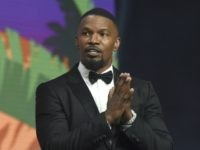 """Jamie Foxx appears on stage to accept the spotlight actor award for his role in """"Just Mercy"""" at the 31st annual Palm Springs International Film Festival Awards Gala on Thursday, Jan. 2, 2020, in Palm Springs, Calif. (AP Photo/Chris Pizzello)"""