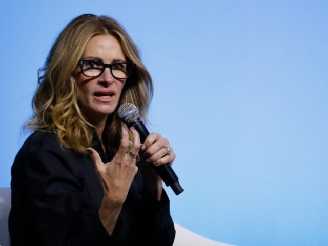 #PassTheMic Julia Roberts speaks during an event for the Obama Foundation in Kuala Lumpur, Malaysia, Thursday, Dec. 12, 2019. Former first lady Michelle Obama and Roberts attended the inaugural Gathering of Rising Leaders in the Asia Pacific organized by the Obama Foundation. (AP Photo/Vincent Thian)