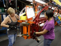 FILE - In this file photo taken June 15, 2010, Patti Burkel, left, and Tasha Livingston install wiring in a car door at General Motors' Lordstown Assembly plant in Lordstown, Ohio. An industry trade group said Wednesday. Sept. 1, 2010, manufacturing companies grew faster in August as the industrial sector …