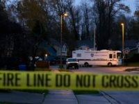 "A Tacoma Police mobile command vehicle remains parked behind yellow tape, Thursday, Dec. 1, 2016, near the home in Tacoma, Wash. where Tacoma Police Officer Reginald ""Jake"" Gutierrez was fatally shot while responding to a domestic violence call Wednesday, Gutierrez died later in the day at a hospital. (AP Photo/Ted …"