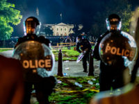 TOPSHOT - Demonstrators confront secret service police and Park police officers outside of the White House on May 30, 2020 in Washington DC, during a protest over the death of George Floyd, an unarmed black man, who died after a Minneapolis police officer kneeled on his neck for several minutes. …