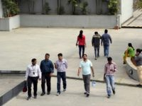 FILE- In this Jan. 18, 2016 file photo, Wipro Ltd. employees walk inside the company's compound during a break at their headquarters in Bangalore, India. The shares of top Indian IT companies are falling in response to news of proposed U.S. legislation that would require salaries for H-1B visa holders …