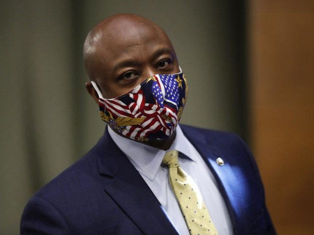 Sen. Tim Scott, R-S.C., wears a face mask as he arrives for a Senate Health Education Labor and Pensions Committee hearing on new coronavirus tests on Capitol Hill in Washington, Thursday, May 7, 2020. (AP Photo/Andrew Harnik, Pool)