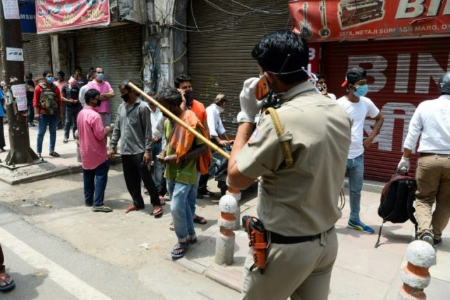 Chaos outside liquor stores as India eases virus lockdown