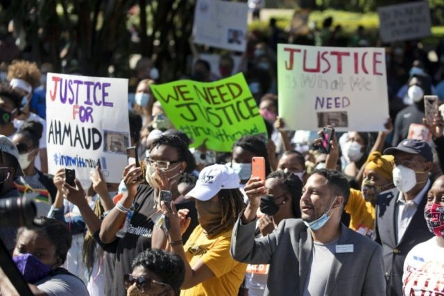 People react during a rally to protest the shooting of Ahmaud Arbery, an unarmed black man Friday, May 8, 2020, in Brunswick Ga. Two men have been charged with murder in the February shooting death of Arbery, whom they had pursued in a truck after spotting him running in their …