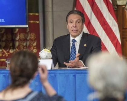 In this April 24, 2020 photo provided by the Office of Governor Andrew M. Cuomo, Gov. Cuomo addresses the media while holding an n95 mask during his daily press briefing on COVID-19, Coronavirus, at the State Capitol in Albany, N.Y. The mask was sent to the governor by a retired …