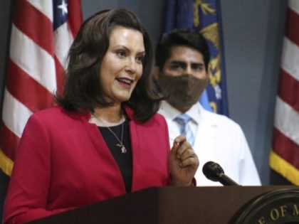 In this Thursday, May 21, 2020 photo provided by the Michigan Office of the Governor, Michigan Gov. Gretchen Whitmer speeks during a news conference in Lansing, Mich. Whitmer is relaxing coronavirus restrictions to lift a ban on nonessential medical and dental procedures, reopen retail shops and let residents gather in …