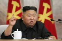 In this undated photo provided on Sunday, May 24, 2020, by the North Korean government, North Korean leader Kim Jong Un speaks during a meeting of the Seventh Central Military Commission of the Workers' Party of Korea in North Korea. Independent journalists were not given access to cover the event …