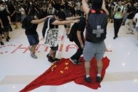 In this Sunday, Sept. 22, 2019, photo, protesters walk on a Chinese national flag during a protest at a mall in Hong Kong. China's decision to impose a national security law on Hong Kong is raising questions about the future of the semi-autonomous Chinese territory. The move bypasses Hong Kong's …