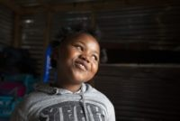 """Lilitha Jiphethu, 11, sings in her first language, Xhosa, inside her home in Orange Farm, South Africa, on Tuesday, April 28, 2020. """"I have a friend in Jesus. He is loving and he's not like any other friend. He is not deceitful. He is not ashamed of us. He is …"""