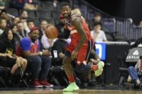 """In this Dec. 1, 2018, file photo, Washington Wizards guard John Wall (2) dribbles the ball during the first half of an NBA basketball game against the Brooklyn Nets in Washington. Wizards point guard John Wall says he is """"110%"""" healthy after missing the past 1? years with two major …"""