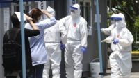 People suspected of being infected with the new coronavirus wait to receive tests at a coronavirus screening station in Bucheon, South Korea, Thursday, May 28, 2020. South Korea on Thursday reported its biggest jump in coronavirus cases in more than 50 days, a setback that could erase some of its …