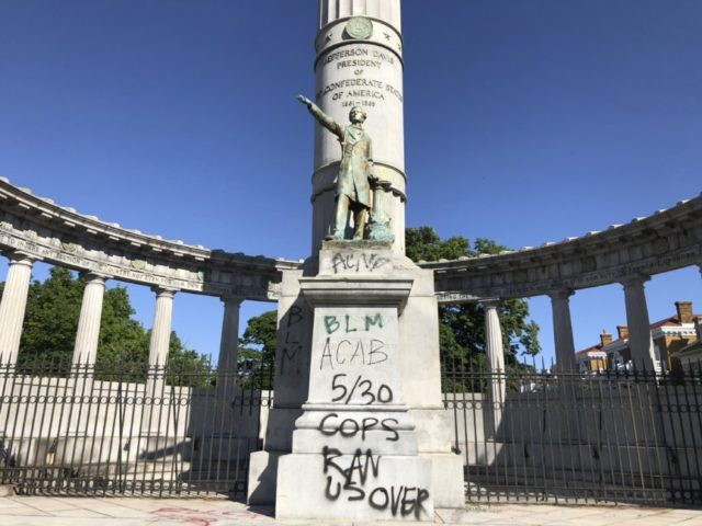 A monument to Confederate President Jefferson Davis in Richmond, Va., is covered with graffiti on Sunday, May 31, 2020, after overnight protests over the death of George Floyd. Many of the city's most prominent Confederate monuments were tagged with similar graffiti. Protests were held in U.S. cities over the death …