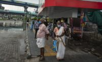People wearing face masks to protect from the new coronavirus as they wait for bus transport in Kochi, Kerala state, India, Monday, June 1, 2020. More states opened up and crowds of commuters trickled on the roads in many cities as India's three-phase plan to lift the virus lockdown kick …