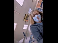 Kentucky woman cuts hole in mask to make it 'easier to breathe'