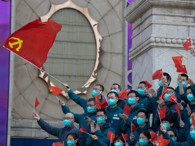 A farewell ceremony is held for the last group of medical workers who came from outside Wuhan to help the city during the coronavirus outbreak in Wuhan in central China's Hubei province on Wednesday, April 15, 2020. Wuhan the epicenter of China's coronavirus outbreak is coming out of more than …