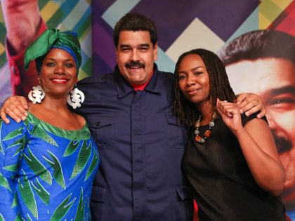 A photo of Opal Tometi, founder of Black Lives Matter, with Venezuelan dictator Nicolas Maduro in New York City, 2015.