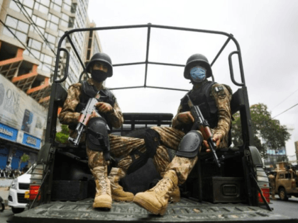 Paramilitary soldiers patrol near the Pakistan Stock Exchange building in Karachi following an attack by Baloch separatists