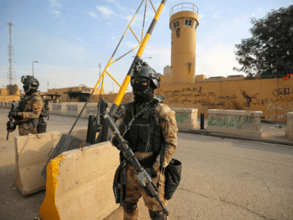Iraqi counter-terrorism forces stand guard outside the US embassy in the capital Baghdad