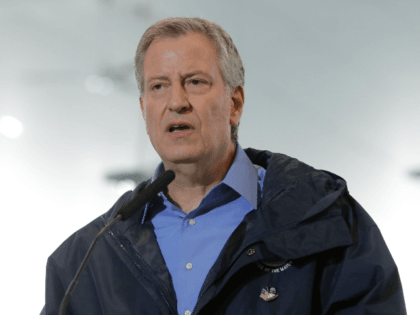 In this March 31, 2020, file photo, New York City Mayor Bill de Blasio speaks at the USTA Indoor Training Center where a 350-bed temporary hospital will be built to support efforts in fight against COVID-19 in New York. De Blasio says on Wednesday, May 20, the city will offer …