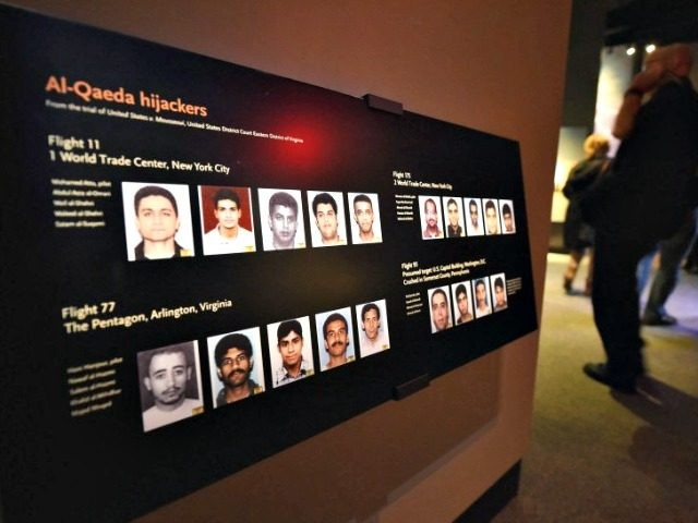 A display at the National September 11 Memorial Museum shows the 9/11 hijackers. A new lawsuit details Saudi officials' alleged role in aiding the 19 hijackers who killed nearly 3,000 people. (STAN HONDA/AFP/Getty Images)
