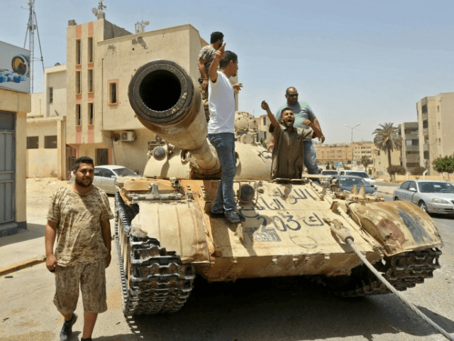 Forces of Libya's UN-recognised unity government patrol the town of Tarhuna, southeast of the Tripoli, after retaking it from fighters loyal to eastern-based strongman Khalifa Haftar