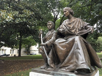 """A monument inscribed """"To the North Carolina Women of the Confederacy"""" is seen on Thursday, Aug. 17, 2017 on the grounds of the old State Capitol in Raleigh, N.C. The 7-foot-tall monument of a woman and young boy is made of bronze and granite, and it was dedicated in 1914. …"""