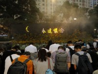 Attendees take part in a public memorial for Marco Leung, the 35-year-old man who fell to his death weeks ago after hanging a protest banner against an extradition bill, in Hong Kong, Thursday, July 11, 2019. The parents of Leung urged young people to stay alive to continue their struggle. …
