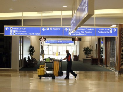 An airport employees pushes a cleaning cart through the terminal at Orlando International Airport after it was closed due to the anticipated arrival of Hurricane Dorian on the East Coast Tuesday, Sept. 3, 2019, in Orlando, Fla. (AP Photo/John Raoux)