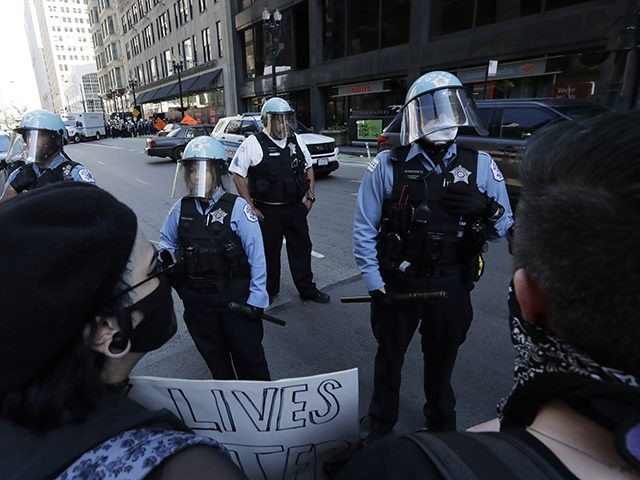 People confront police officers during a protest over the death of George Floyd in Chicago, Saturday, May 30, 2020.Protests were held throughout the country over the death of Floyd, a black man who died after being restrained by Minneapolis police officers on May 25. (AP Photo/Nam Y. Huh)