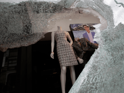 Mannequins are shown behind a broken window to a Brooks Brothers store in San Francisco, Sunday, May 31, 2020, after protests over the Memorial Day death of George Floyd. Floyd was a black man who was killed in police custody in Minneapolis on May 25. (AP Photo/Jeff Chiu)