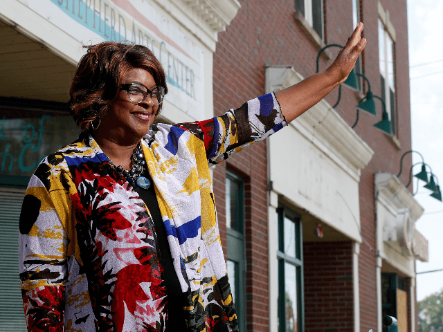 Mayor-elect Ella Jones waves to a supporter passing by while posing for a photo Wednesday, June 3, 2020, in Ferguson, Mo. Jones, currently a city council member who was elected mayor on Tuesday, will become the first black and first woman mayor of the city thrust into the national spotlight …