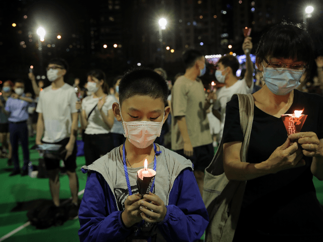 Participants holds candles during a vigil for the victims of the 1989 Tiananmen Square Massacre at Victoria Park in Causeway Bay, Hong Kong, Thursday, June 4, 2020, despite applications for it being officially denied. China is tightening controls over dissidents while pro-democracy activists in Hong Kong and elsewhere try to …