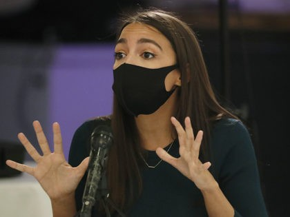 U.S. Rep. Alexandria Ocasio-Cortez, D, New York, makes a point during a debate againsy opponent Michelle Caruso-Cabrera ahead of New York's June 23 primary, Wednesday, June 17, 2020, in the Bronx borough of New York. The even was broadcast on Facebook live. (AP Photo/Kathy Willens)